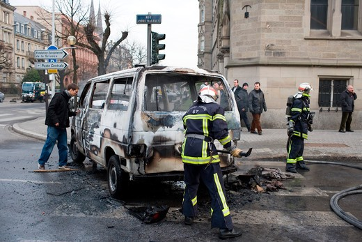 Stock Photo: 4285-11930 january 2006 torched car and firemen during dock workers protest march strasbourg alsace france