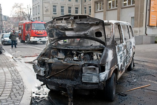 Stock Photo: 4285-11933 january 2006 torched car during dock workers protest march strasbourg alsace france