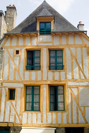 yellow half-timbered house jerzual street dinan brittany france : Stock Photo