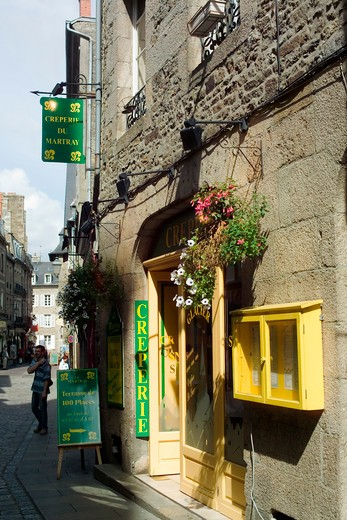 yellow pancake restaurant's entrance dinan brittany france : Stock Photo