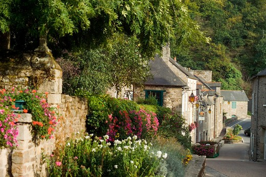 flowerbeds and houses leon near dinan brittany france : Stock Photo
