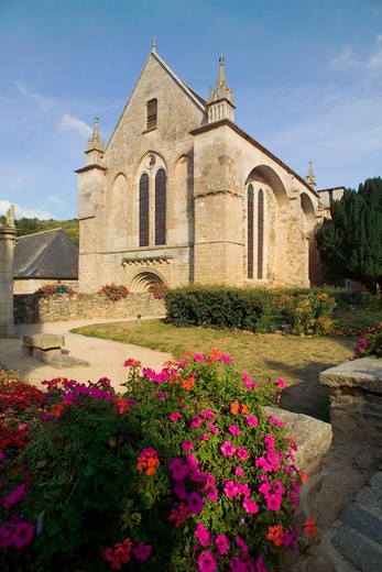 flowerbed and prieure st-magloire priory leon near dinan brittany france : Stock Photo