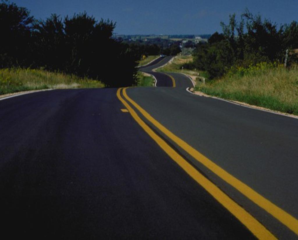 Stock Photo: 4285-1216 Kansas road with car, KS