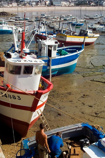trawler fishing boats at low tide erquy harbour brittany france : Stock Photo