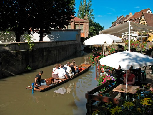 boat trip and cafe terrace petite venise little venice in tanner's district colmar alsace france : Stock Photo