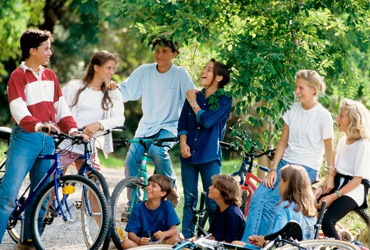 mr group of children and teenagers with bikes : Stock Photo