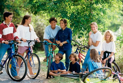 Stock Photo: 4285-13170 mr group of children and teenagers with bikes