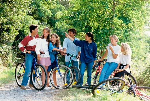 mr group of 7 teenagers with bikes : Stock Photo
