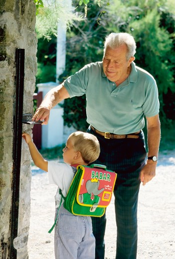 Stock Photo: 4285-13210 mr grandfather walking little boy to school