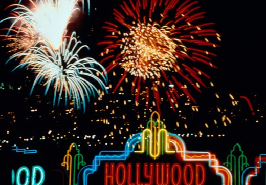 Neon Hollywood sign with fireworks at night. : Stock Photo