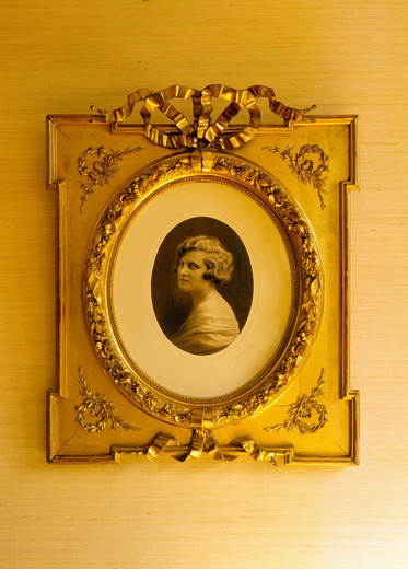 Stock Photo: 4285-13694 MR ANTIQUE PHOTO OF A WOMAN IN GOLDEN FRAME