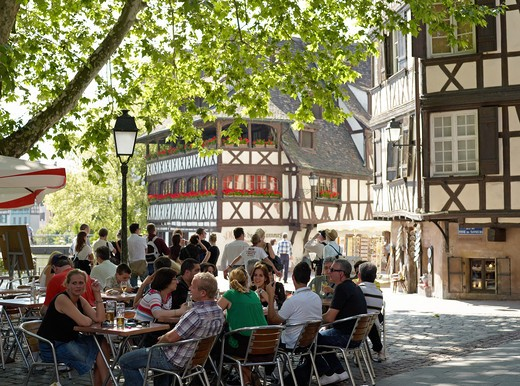 Stock Photo: 4285-13915 SHADOWED CAFE TERRACE BENJAMIN ZIX SQUARE WITH HALF-TIMBERED HOUSES LA PETITE FRANCE DISTRICT STRASBOURG ALSACE FRANCE