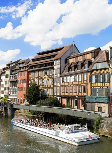 Stock Photo: 4285-13932 TOURIST TOUR BOAT ON ILL RIVER AND HALF-TIMBERED HOUSES LA PETITE FRANCE DISTRICT STRASBOURG ALSACE FRANCE