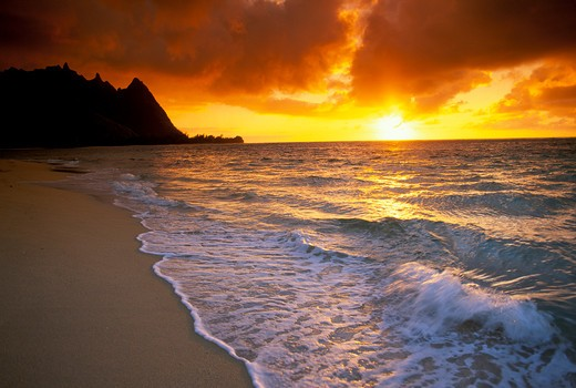 Stock Photo: 4285-1399 Golden sunset over surf, sand and peaks from Tunnels Beach, North Shore Kauai, Ha?ena, HI.