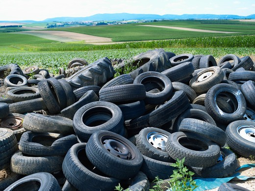 Stock Photo: 4285-14005 OLD CAR TIRES DUMPED ON FARMLAND ALSACE FRANCE