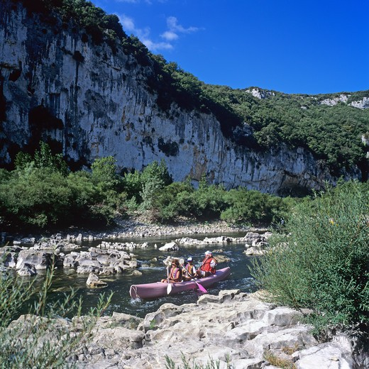 COUPLE AND TEENAGER CANOEING ON RIVER GORGES DE L'ARDECHE ARDECHE GORGE FRANCE : Stock Photo
