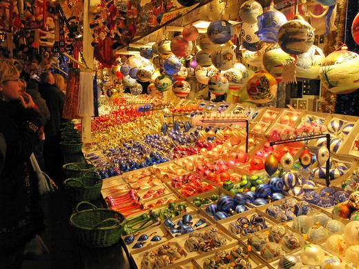 Stock Photo: 4285-14309 CHRISTMAS DECORATIVE PROPS STALL AND PEOPLE AT CHRISTKINDELSMŽRIK CHRISTMAS MARKET STRASBOURG ALSACE FRANCE
