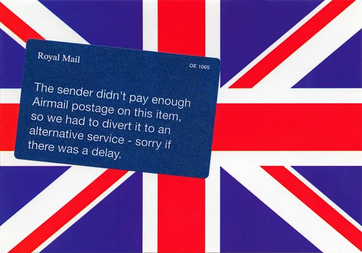 Stock Photo: 4285-14584 POSTCARD WITH UNION JACK FLAG AND ROYAL MAIL LATE DELIVERY NOTICE