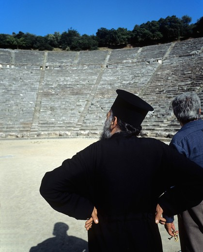 POPE ORTHODOX PRIEST IN ANTIQUE THEATRE OF EPIDAURUS PELOPONNESE GREECE : Stock Photo