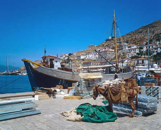 Stock Photo: 4285-14949 DONKEY QUAYSIDE FISHING BOAT HYDRA HARBOUR SARONIC GULF ISLAND GREECE