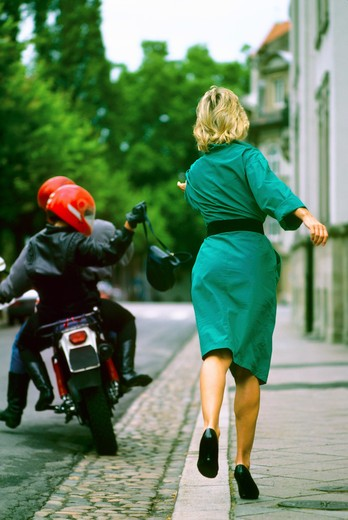 Stock Photo: 4285-15082 MR THIEVES ON MOTORCYCLE STEALING WOMAN'S PURSE