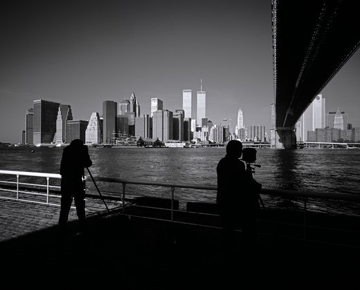 Stock Photo: 4285-15318 PRE 9/11 PHOTOGRAPHERS TAKING PICTURES OF LOWER MANHATTAN SKYLINE WITH EAST RIVER AND BROOKLYN BRIDGE NEW YORK USA