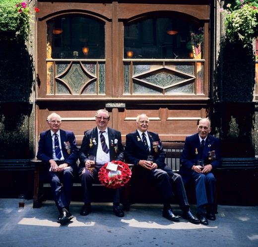 Stock Photo: 4285-15431 NORMANDY VETERANS SITTING OUTSIDE RED LION PUB LONDON ENGLAND GB UK