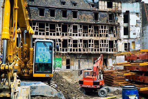 Stock Photo: 4285-15578 YELLOW DIGGER AND RED CRANE ON BUILDING SITE ANCIENT HOUSE RENOVATION STRASBOURG ALSACE FRANCE