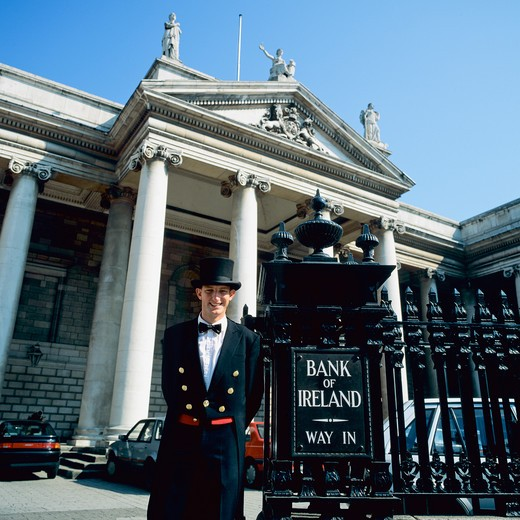 Stock Photo: 4285-15692 SMILING DOORMAN BANK OF IRELAND DUBLIN IRELAND
