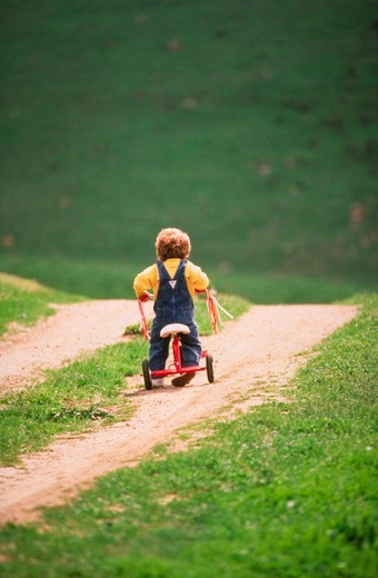 Stock Photo: 4285-16274 Riding Uphill  Something to do with the travails of childhood and life. MR