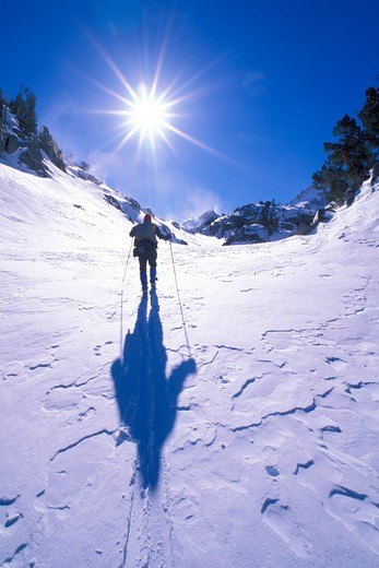 Stock Photo: 4285-1650 Backcountry skier crossing wind blown snow near Treasure Lakes, Little Lakes Valley, John Muir Wilderness, California