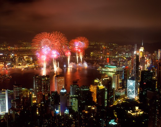 Victoria Harbor and Fireworks from Victoria Peak showing skyline of Special Administration Region, Hong Kong, China : Stock Photo
