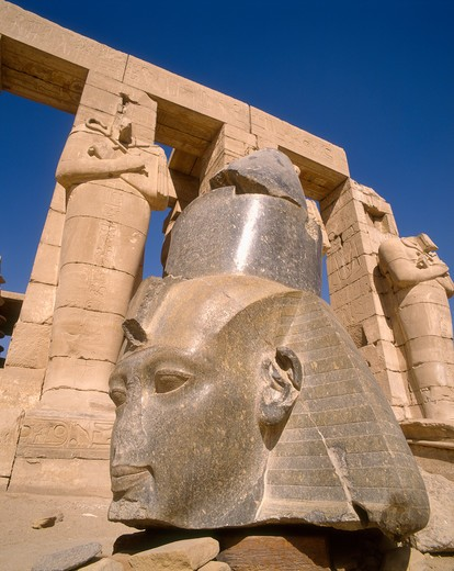 Stock Photo: 4285-17482 Statues of Ramses 2nd and Osiris Pillars on the West Bank of the Nile at Luxor, Egypt