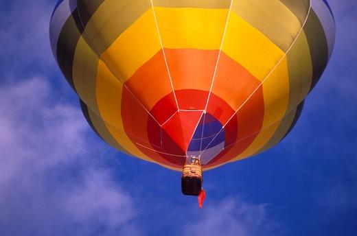 Stock Photo: 4285-1773 Hot air balloon rising in morning light at the International Balloon Fiesta, Albuquerque, New Mexico