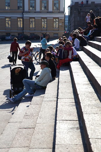 Stock Photo: 4285-18450 Finland, Helsinki, Helsingfors, Senate Square, Tourists Resting on the Steps of The Cathedral