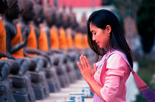 Thailand, Ayudhaya, Thai Girl Praying at Temple MR46-15 : Stock Photo