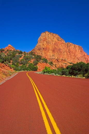 Sandstone cliff and red road in the Kolob Canyons area, Zion National Park, Utah : Stock Photo