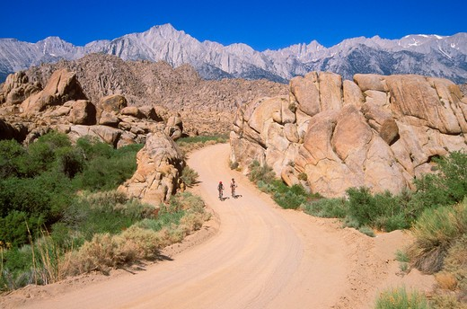Stock Photo: 4285-2070 Mountain bikers on dirt road in the Alabama Hills under Mount Whitney (highest point in continental US), Owens Valley, Eastern Sierra Nevada Mountains, California