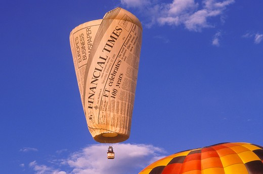 Stock Photo: 4285-2170 Financial Times hot air balloon rising in dawn light at the International Balloon Fiesta, Albuquerque, New Mexico