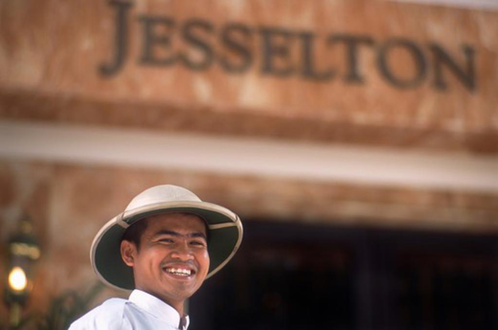 Stock Photo: 4285-21881 Malaysia, Borneo, Sabah, Kota Kinabalu, Jesselton Hotel, Doorman