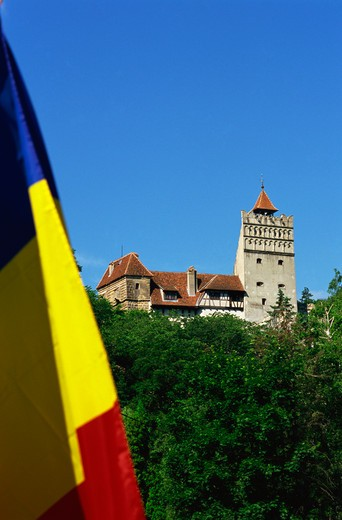 Stock Photo: 4285-23059 Romania,Transylvania, Brasov County, Bran, Bran Castle (Dracula?s Castle), Romanian Flag