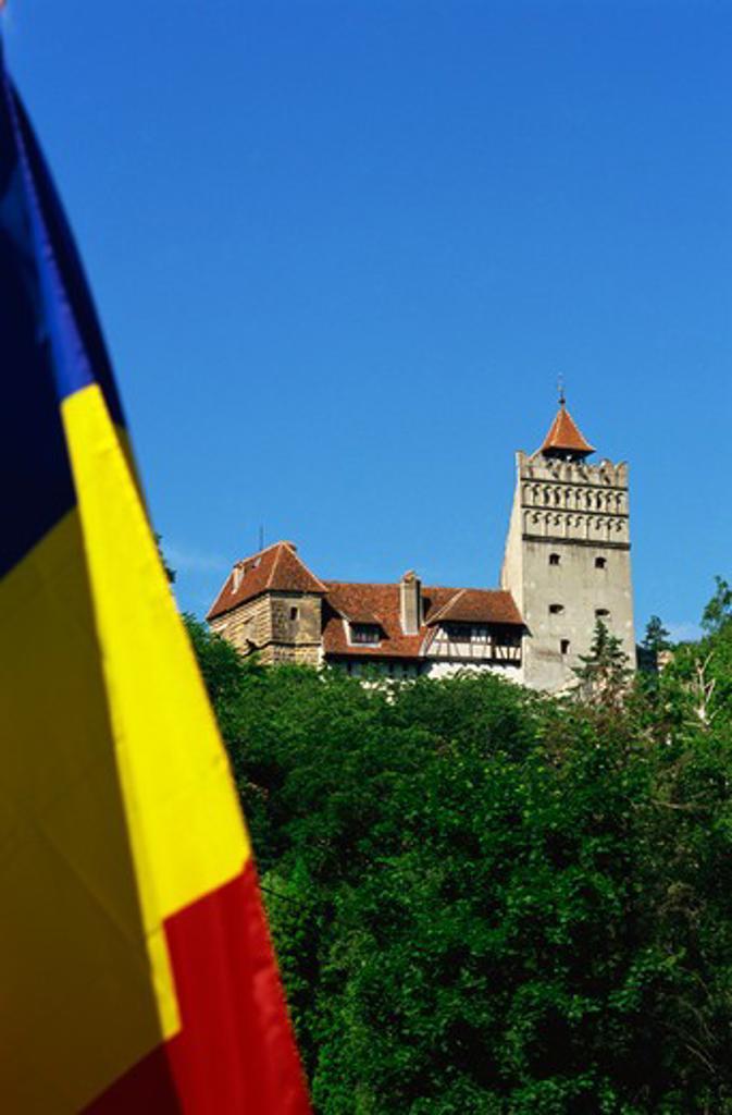 Romania,Transylvania, Brasov County, Bran, Bran Castle (Dracula?s Castle), Romanian Flag : Stock Photo