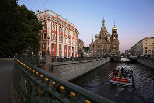 Stock Photo: 4285-23947 Russia, St Petersburg, Church of the Resurrection (Church on Spilled Blood), Griboedov Canal, Theatre Bridge, Tourist Boat. Sunset