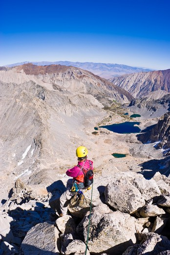 Climber on the northeast ridge of  Bear Creek Spire, John Muir Wilderness, Sierra Nevada Mountains, California : Stock Photo