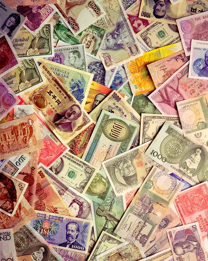 Colorful montage of various forms of international currency . : Stock Photo