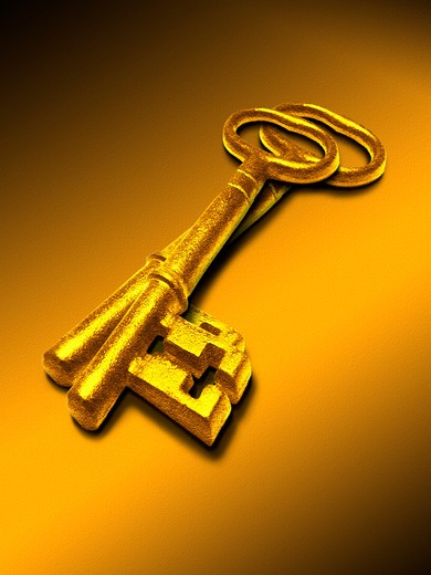Stock Photo: 4285-2986 Two antique gold keys shine under the studio lights on an orange background.