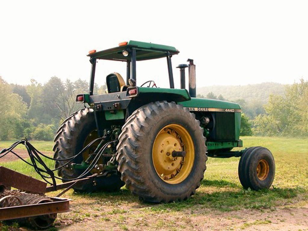 Stock Photo: 4285-3411 older john deere green tractor on grass