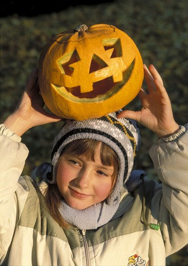 Stock Photo: 4285-4107 Halloween Girl with pumpkin