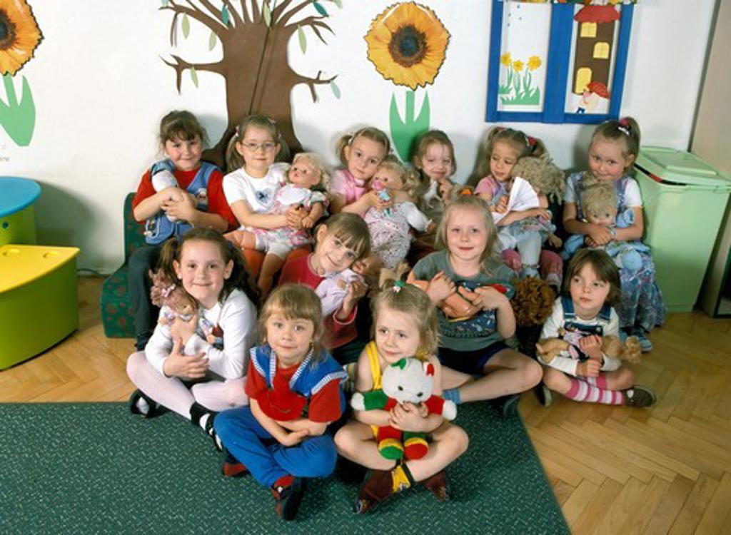 Stock Photo: 4285-4197 nursery school, girls with dolls, sitting, kindergarten,   MR9023-34