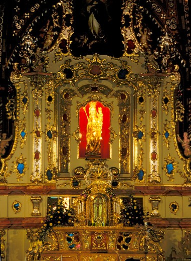 Stock Photo: 4285-4374 Ludzmierz Sanctuary, Poland  Sanctuary of Ludzmierz with its magnificiant icon of the Virgin the Queen of Podhale In 1963 during the crowning ceremony as the feretory bearing the figure was being carried the scepter fell from its hands It was caught in mid-air by then the Bishop of Krakow then Karol Wojtyla who years later went on to become Pope Ludzmierz is the oldest village in the Podhale region (13th century) Also famous for its miraculous likeness of the Mother of God